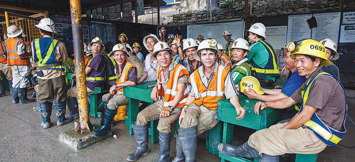 Workers at a Besra gold mining property in Vietnam prior to a shift change.